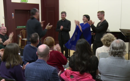 Tom joins the performers for applause after Niel's 'Exile' cycle